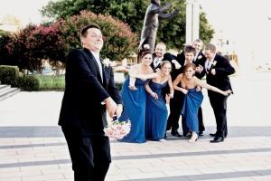 Groom throwing bouquet
